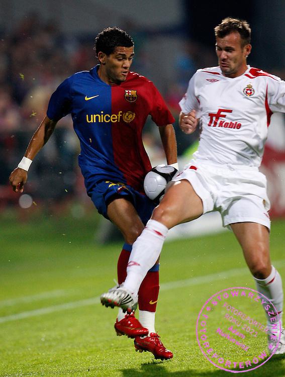 KRAKOW 26/08/2008.UEFA CHAMPIONS LEAGUE.THIRD QUALIFYING ROUND.SECOND LEG.WISLA KRAKOW v FC BARCELONA.NA ZDJ. DANIEL ALVES /BARCELONA/ AND MAREK ZIENCZUK /WISLA/.FOT. PIOTR HAWALEJ / WROFOTO.