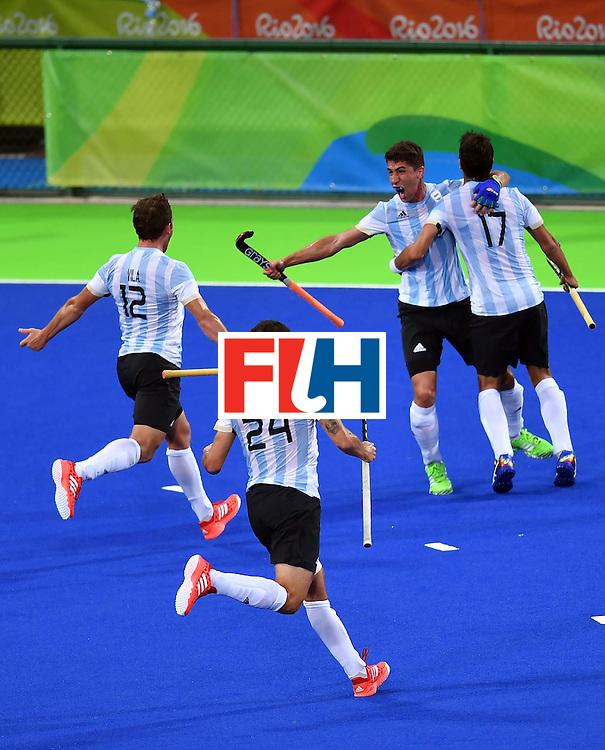 Argentina's Ignacio Ortiz (2nd R) celebrates a goal with teammates during the men's Gold medal field hockey Belgium vs Argentina match of the Rio 2016 Olympics Games at the Olympic Hockey Centre in Rio de Janeiro on August 18, 2016. / AFP / MANAN VATSYAYANA        (Photo credit should read MANAN VATSYAYANA/AFP/Getty Images)