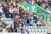 Paul Robinson defender for AFC Wimbledon (6) and Plymouth Argyle defender Jamille Matt  (19) battle for the ball during the Sky Bet League 2 match between Plymouth Argyle and AFC Wimbledon at Home Park, Plymouth, England on 9 April 2016. Photo by Stuart Butcher.