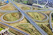 Nederland, Friesland, Gemeente Heerenveen, 01-05-2013; knooppunt Heerenveen, klaverblad. Kruising A32 naar Leeuwarden en Meppel / Zwolle, A7 naar Joure en Drachten / Groningen. Foto richting Heerenveen.<br /> Junction Heerenveen (Friesland, Northern Netherlands, cloverleaf.<br /> luchtfoto (toeslag op standard tarieven)<br /> aerial photo (additional fee required)<br /> copyright foto/photo Siebe Swart