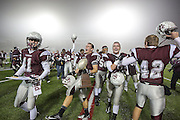 Cameron Yoe players celebrate after defeating White Oak in the Class 2A Division I semifinal at Eagle Stadium in Allen on Friday, Dec. 13, 2013.