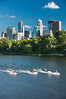 Jet skiers on the Mississippi river with the Minneapolis, Minnesota skyline as a backdrop on a warm summer afternoon.