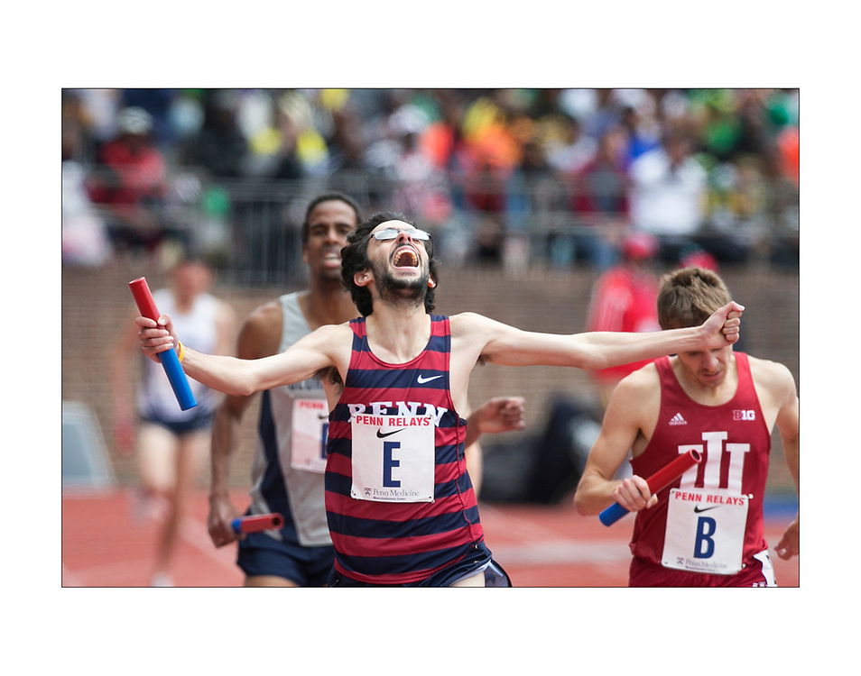 On the final day of this years Penn Relays, anchor Thomas Awad celebrates and makes history as he crosses the finish line to win the 4xMile relay for Penn, their first win in 40 years.  ED HILLE / Staff Photographer