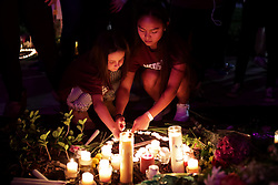 People light candles for a makeshift memorial after an interfaith ceremony at Pine Trails Park in Parkland, FL, USA, to remember the 17 victims killed last year at Marjory Stoneman Douglas High School, on Thursday, February 14, 2019. Photo by John McCall/Sun Sentinel/TNS/ABACAPRESS.COM