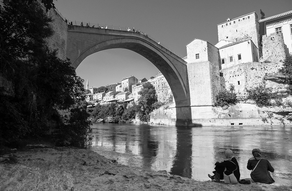 The Siege of Mostar peaked in 1993 during the Croat-Bosniak conflict lasting eighteen months as fighting took place as Bosnia and Herzegovina declared independence from Yugoslavia. The city was divided in half between the two battling armies. Mostar, dating back over four hundred years, was mostly destroyed through the fighting. Although reconstruction has slowly commenced in the last decades, evidence of the war remains in bullet ravaged buildings still standing throughout the city.