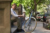 Man sitttng on stone steps