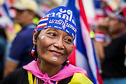 05 JANUARY 2014 - BANGKOK, THAILAND: An anti-government protestor in Bangkok Sunday. Suthep Thaugsuband, leader of the anti-government protests in Bangkok, led the protestors on a march through the Chinatown district of Bangkok. Tens of thousands of people waving Thai flags and blowing whistles gridlocked what was already one of the most congested parts of the city. The march was intended to be a warm up to their plan by protestors to completely shut down Bangkok starting Jan. 13.     PHOTO BY JACK KURTZ