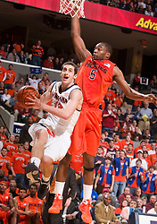 Virginia guard Sammy Zeglinski (13) heads to the basket past Virginia Tech guard Dorenzo Hudson (5).  The Virginia Cavaliers defeated the Virginia Tech Hokies 75-61 at the John Paul Jones Arena on the Grounds of the University of Virginia in Charlottesville, VA on February 18, 2009.
