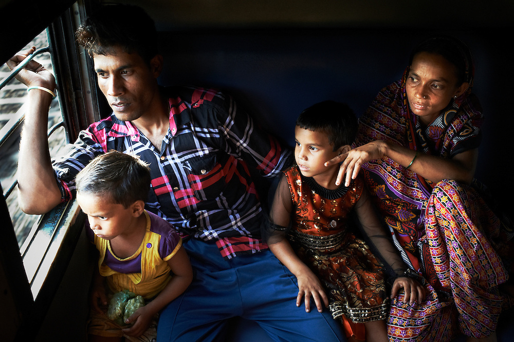 Ashraful, 27 years old, his wife Menaron, 24 years old, daughters Sonali, 5 years old and Sulekha, 3 years old sit on the Howrah Express from New Delhi to Calcutta, India on September 4, 2013. traveling from New Delhi to Calcutta on September 4, 2013. They have just  spent 6 weeks in the village visiting family.