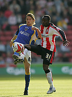 Photo: Lee Earle.<br /> Southampton v Cardiff City. Coca Cola Championship. 21/10/2007. Cardiff's Glenn Loovens (L) clashes with Stern John.