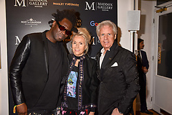 Left to right, artist Bradley Theodore, Danielle Nicholls and James Nicholls at a private view of work by Bradley Theodore entitled 'The Second Coming' at the Maddox Gallery, 9 Maddox Street, London England. 19 April 2017.