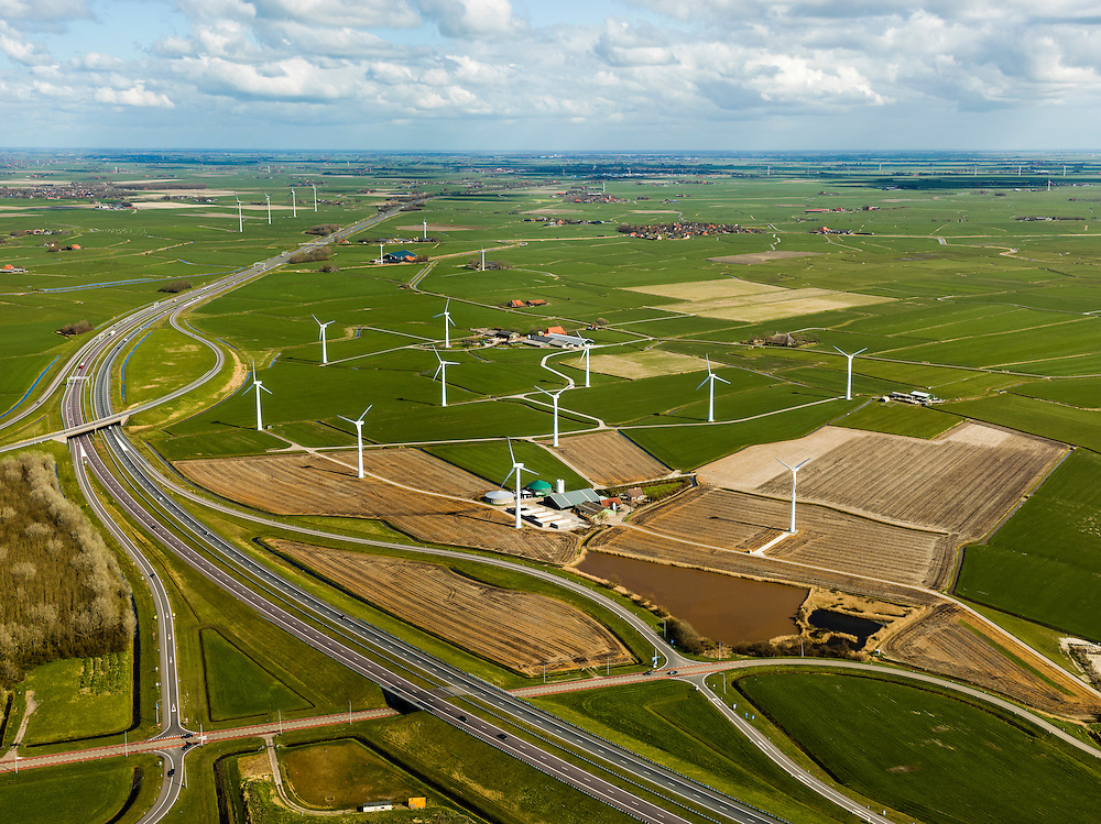 Nederland, Friesland, Gemeente Wonseradeel, 16-04-2012; windmolenpark ten zuiden van Zurich, in de Gooijumer- en Zuricherpolder. Knooppunt Zurich A7 richting Bolsward..Windpark in the Polder in the North of the Netherlnds, near the coast of the Waddensea..luchtfoto (toeslag), aerial photo (additional fee required);.copyright foto/photo Siebe Swart