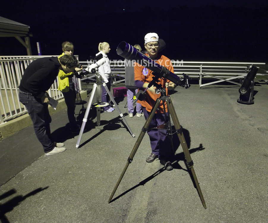 New Paltz, New York - A member of the Mid-Hudson Astronomical Association sets up telescopes for International Observe the Moon Night at Smolen Observatory at SUNY New Paltz on Sept. 18, 2010. ©Tom Bushey / The Image Works