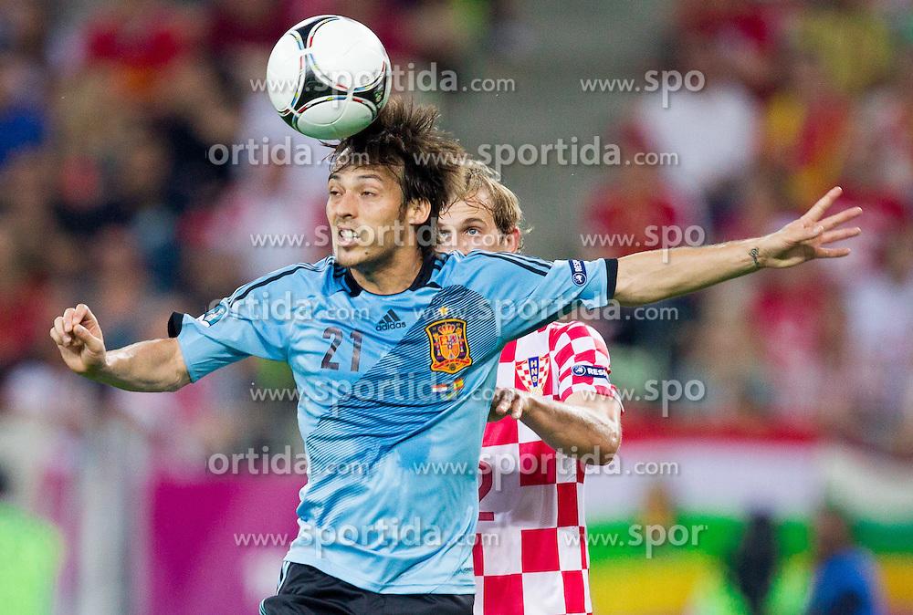 David Silva of Spain vs Ivan Strinic of Croatia during the UEFA EURO 2012 group C match between  Croatia and Spain at PGE Arena Gdansk on June 18, 2012 in Gdansk / Danzig, Poland. (Photo by Vid Ponikvar / Sportida.com)
