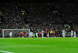 Fans at Old Trafford take photos as Argentina's Lionel Messi takes a free kick  - Photo mandatory by-line: Joe Meredith/JMP - Mobile: 07966 386802 - 18/11/14 - SPORT - Football - Manchester - Old Trafford - Argentina v Portugal - International Friendly