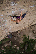 "Professional climber Emily Harrington climbing ""Schoolsout"" rated 10d, ""Slavery Crag"" Ten Sleep Canyon Wyoming."