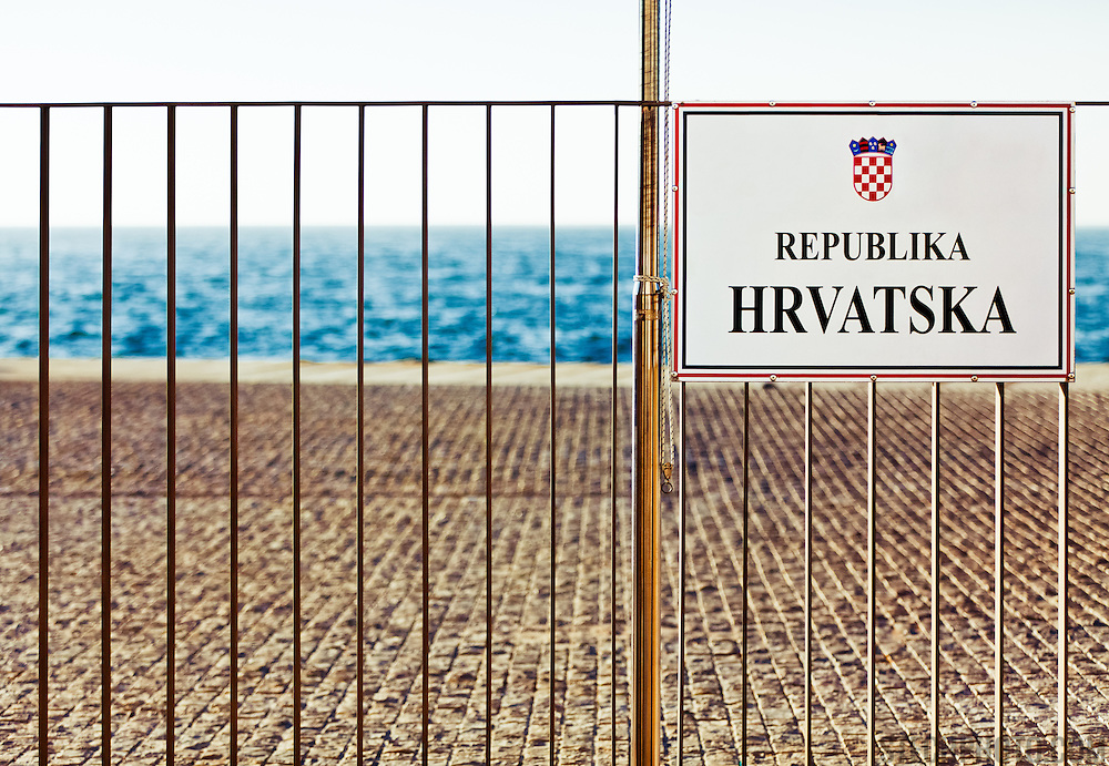 A sign and a fenced off area near the dock in Zadar, Croatia (Hrvatska).
