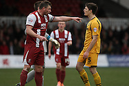 Tempers fray as Steve Elliott of Cheltenham Town and Ryan Burge of Newport County (r) have a disagreement. Skybet football league 2 match, Newport county v Cheltenham Town at Rodney Parade in Newport, South Wales on Saturday 22nd Feb 2014.<br /> pic by Mark Hawkins, Andrew Orchard sports photography.