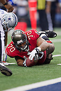 DALLAS, TX - SEPTEMBER 23:  Donald Penn #70 of the Tampa Bay Buccaneers recovers a fumble during a game against the Dallas Cowboys at Cowboys Stadium on September 23, 2012 in Dallas, Texas.  The Cowboys defeated the Buccaneers 16-10.  (Photo by Wesley Hitt/Getty Images) *** Local Caption *** Donald Penn