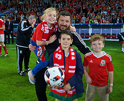 LILLE, FRANCE - Friday, July 1, 2016: Wales' equipment manager David Griffiths with his family on the pitch after a 3-1 victory over Belgium and reaching the Semi-Final during the UEFA Euro 2016 Championship Quarter-Final match at the Stade Pierre Mauroy. (Pic by David Rawcliffe/Propaganda)