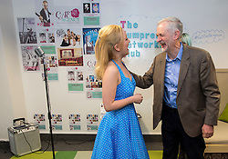 © Licensed to London News Pictures. 26/09/2015. Brighton, UK. Leader of the Labour Party JEREMY CORBYN talking to singer FARRAH JOY while visiting Entrepreneurial Spark in Brighton, a group tht promotes entrepreneuring. The visit takes place on the eve of the Labour Party conference, which is being held in Brighton  Photo credit: Ben Cawthra/LNP