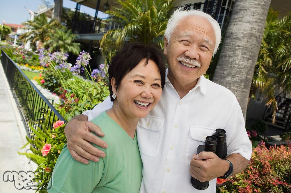 Smiling Couple with Binoculars