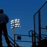 USA, Washington, Everett, Fan watches Everett Aquasox Class A minor league baseball game after sunset