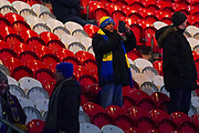 A AFC Wimbledon fan taking a photo during the The FA Cup match between Doncaster Rovers and AFC Wimbledon at the Keepmoat Stadium, Doncaster, England on 19 November 2019.