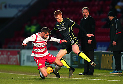 Rory Gaffney of Bristol Rovers take on Matty Blair of Doncaster Rovers - Mandatory by-line: Robbie Stephenson/JMP - 27/01/2018 - FOOTBALL - The Keepmoat Stadium - Doncaster, England - Doncaster Rovers v Bristol Rovers - Sky Bet League One
