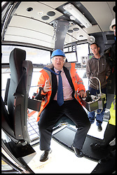 Mayor of London visits DP World London Gateway.<br /> The Mayor of London, Boris Johnson in the driving seat of a crane during a visit to the DP World London Gateway site to see for himself the progress made on its construction and to discuss the benefits the port will have for London,<br /> Essex, United Kingdom<br /> Tuesday, 30th July 2013<br /> Picture by Andrew Parsons / i-Images