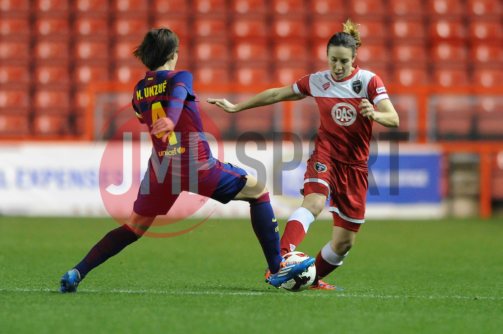 Bristol Academy Womens' Corinne Yorston is tackled by FC Barcelona's Marta Unzue - Photo mandatory by-line: Dougie Allward/JMP - Mobile: 07966 386802 - 13/11/2014 - SPORT - Football - Bristol - Ashton Gate - Bristol Academy Womens FC v FC Barcelona - Women's Champions League