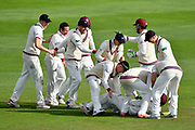 Wicket - Marcus Trescothick of Somerset is mobbed after taking a catch to dismiss Stevie Eskinazi of Middlesex off the bowling of Roelof van der Merwe of Somerset during the Specsavers County Champ Div 1 match between Somerset County Cricket Club and Middlesex County Cricket Club at the Cooper Associates County Ground, Taunton, United Kingdom on 28 September 2017. Photo by Graham Hunt.