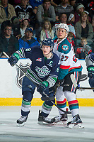 KELOWNA, CANADA - APRIL 30: Calvin Thurkauf #27 of the Kelowna Rockets checks Scott Eansor #8 of the Seattle Thunderbirds on April 30, 2017 at Prospera Place in Kelowna, British Columbia, Canada.  (Photo by Marissa Baecker/Shoot the Breeze)  *** Local Caption ***