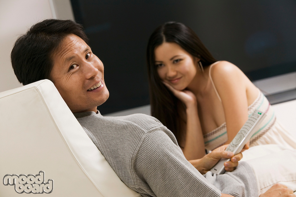 Couple in Chair with Remote Control
