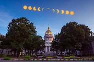 The 2017 eclipse over the capitol of West Virginia is represented in this composite depicting the phases of the eclipse at several timed intervals.
