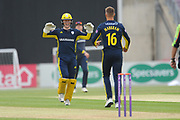 Tom Alsop and Aiden Markram of Hampshire celebrate the wicket of Eoin Morgan during the Royal London One Day Cup match between Hampshire County Cricket Club and Middlesex County Cricket Club at the Ageas Bowl, Southampton, United Kingdom on 23 April 2019.