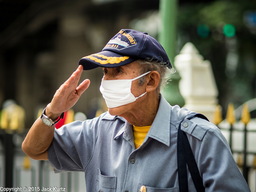 03 SEPTEMBER 2015 - BANGKOK, THAILAND: A veteran of the Royal Thai Marines salutes after praying at Erawan Shrine. Repairs to Erawan Shrine were completed Thursday, Sept 3 after the shrine was bombed on August 17. Twenty people were killed in the bombing and more than 100 injured. The statue of the Four Faced Brahma in the shrine was damaged by shrapnel and a building at the shrine was damaged by debris.    PHOTO BY JACK KURTZ