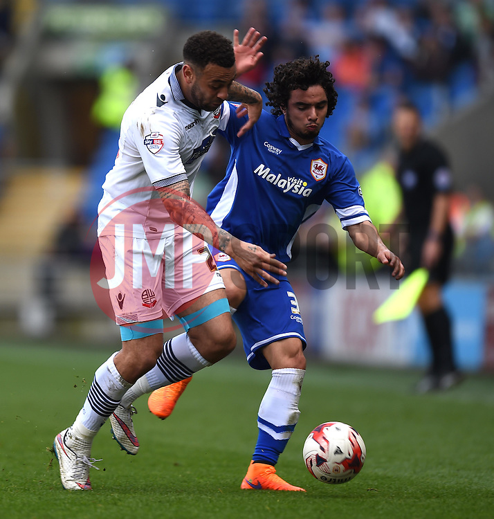 Bolton Wanderers' Craig Davies competes with Cardiff City's Fabio Da Silva - Photo mandatory by-line: Paul Knight/JMP - Mobile: 07966 386802 - 06/04/2015 - SPORT - Football - Cardiff - Cardiff City Stadium - Cardiff City v Bolton Wanderers - Sky Bet Championship