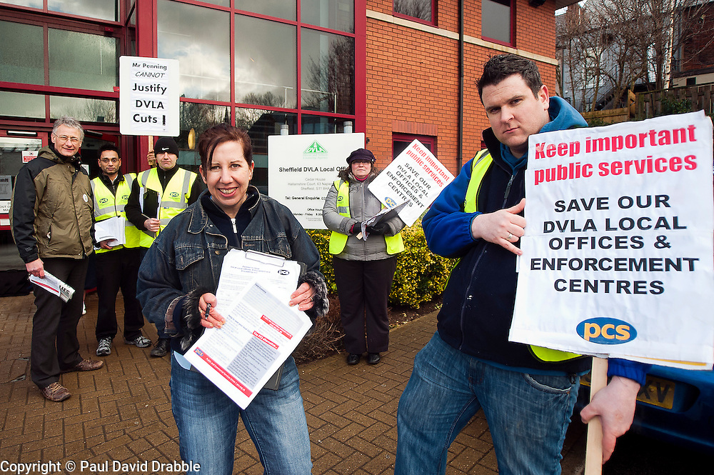 PCS members and supporters in Sheffield stage an eight-hour demonstration to protest  against the planned closure of the local office of the Driver and Vehicle Licensing Agency (DVLA). The protest was called to coincide with a visit to the premises by transport minister Mike Penning.on Monday (23 January) but according to Mike Mackie, assistant secretary of the PCS northern branch for the DVLA, the visit was canceled within 15 minutes of the Sheffield Demo being announced on the PCS website..Alistair Tice Shajahn Miah, Mark Devlin, Lauraine Compton with Sheffield Office Employee Rosalyn Jewitt and  Mike Mackie, assistant secretary of the PCS northern branch for the DVLA outside the Sheffield Office..www.pauldaviddrabble.co.uk..23 January 2012 -  Image © Paul David Drabble