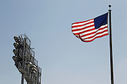 LOS ANGELES, CA - MAY 27:  An American flag flies over the stadium with light stands in the background before the Los Angeles Dodgers game against the Houston Astros on Sunday, May 27, 2012 at Dodger Stadium in Los Angeles, California. The Dodgers won the game 5-1. (Photo by Paul Spinelli/MLB Photos via Getty Images)