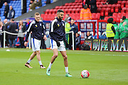 Leicester City midfielder Riyad Mahrez (26) in the warm up  with Leicester City forward Jamie Vardy (9) in the background warm up before the Barclays Premier League match between Crystal Palace and Leicester City at Selhurst Park, London, England on 19 March 2016. Photo by Phil Duncan.