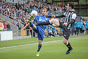 Kevin Roberts (Captain) (Halifax) stretches to control the ball while under pressure from Adam Blakeman (Chorley) during the Vanarama National League North Play Off final match between FC Halifax Town and Chorley at the Shay, Halifax, United Kingdom on 13 May 2017. Photo by Mark P Doherty.
