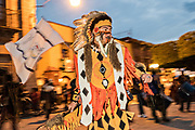 A man dressed in Native American costume performs the Concheros dance during the week long fiesta of the patron saint Saint Michael September 26, 2017 in San Miguel de Allende, Mexico.
