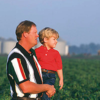 Bill and Houston Griffith stand in a soybean field on their farm in Skene.