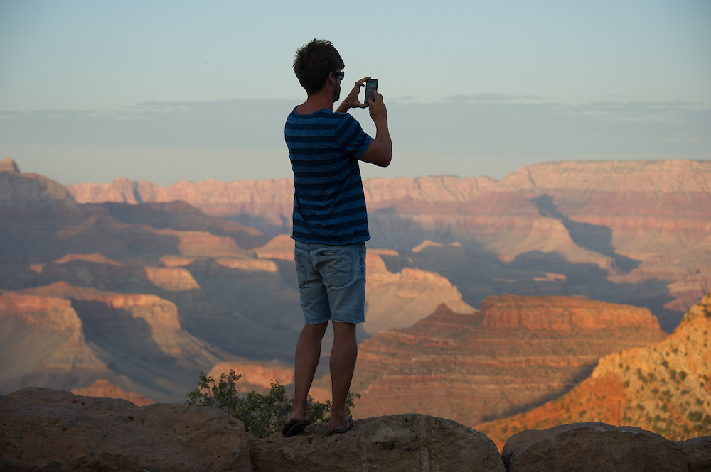 Tourist Taking Pictures of Grand Canyon
