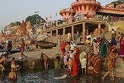 Dashashwamedh Ghat is the most visited ghat of Varanasi by religious pilgrims, Dashashwamedh ghat is the most beautiful ghat in city. The ghat is close to the famous 'Vishwanath Temple' and is therefore of high religious importance. The most enticing part is the evening 'Puja' performed by the group of priests. Also called as 'Fire Puja', the ceremony is a dedication to River Ganges, Sun, Lord Shiva, Fire and the whole universe. The Ghats finds mention in the old religious texts, as it is said that lord Brahma created the ghats to welcome lord Shiva.  Early morning.  Varanasi, India..