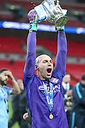 Manchester City goalkeeper Wilfredo Caballero (13)  lifts the cup during the Capital One Cup match between Liverpool and Manchester City at Anfield, Liverpool, England on 28 February 2016. Photo by Simon Davies.