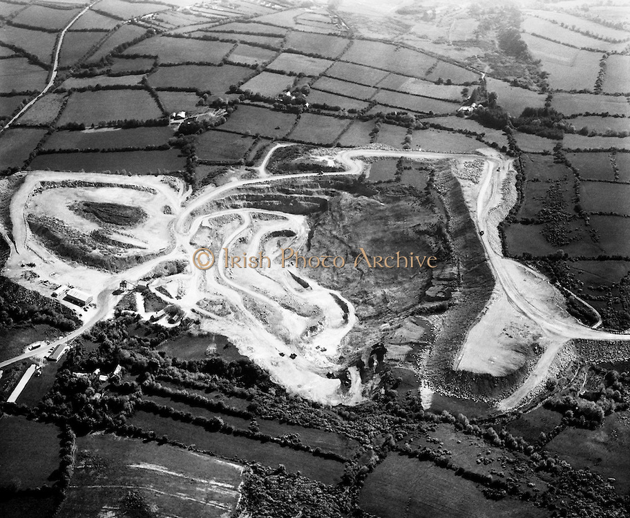 an aerial view of Silvermines, Co Tipperary where mining has been going on intermittently over the centuries. Opencast mining of barytes began in 1963 and lead and zinc were also discovered. This was worked underground from 1968 to 1982 by Mogul of Ireland Ltd. The mine closed in 1992.<br /> 14/11/1974