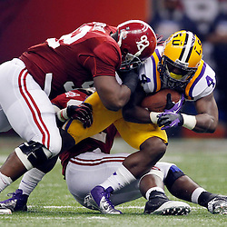 Jan 9, 2012; New Orleans, LA, USA; LSU Tigers running back Alfred Blue (4) is tackled by Alabama Crimson Tide defensive lineman Damion Square (92) during the first half of the 2012 BCS National Championship game at the Mercedes-Benz Superdome.  Mandatory Credit: Derick E. Hingle-US PRESSWIRE