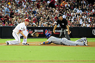 Sep. 27 2011; Phoenix, AZ, USA; Los Angeles Dodgers outfielder Matt Kemp (27) is called safe after sliding into third base against the Arizona Diamondbacks  third basemen Geoff Blum (27)  during the fourth inning at Chase Field.  Mandatory Credit: Jennifer Stewart-US PRESSWIRE.